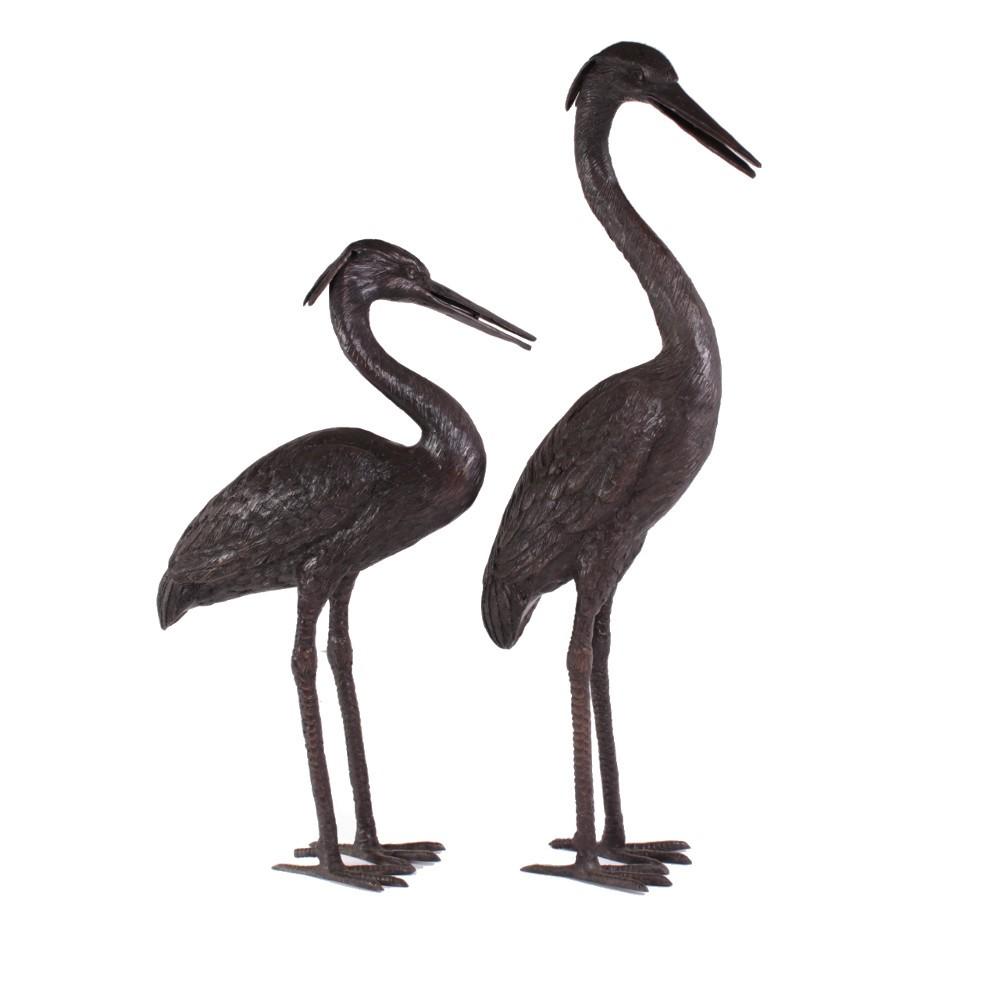 Twee prachtige bronzen reigers